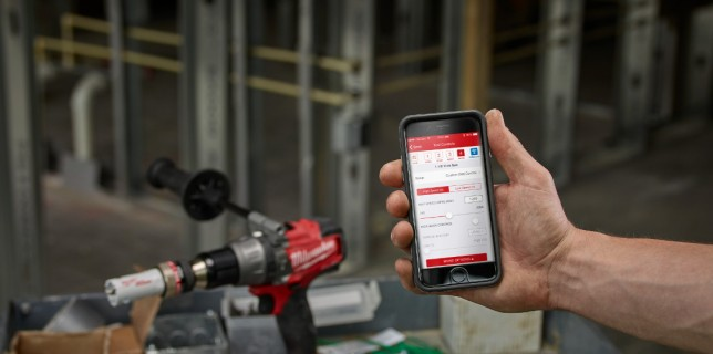 Milwaukee One-Key enabled drill and phone showing One-Key app